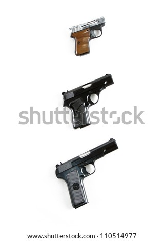 Modern automatic hand gun pistols isolated on white background