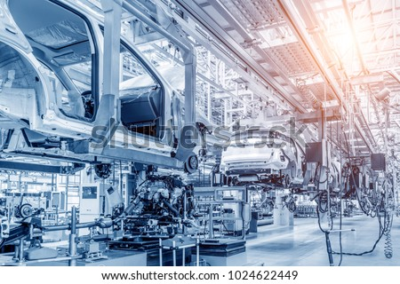 Modern automobile production line, automated production equipment. Stockfoto ©