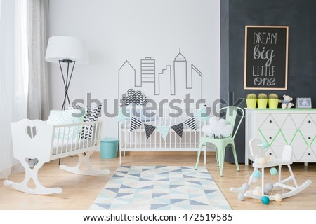 Modern baby room interior with cod, cradle, cockhorse and mint decorations #472519585