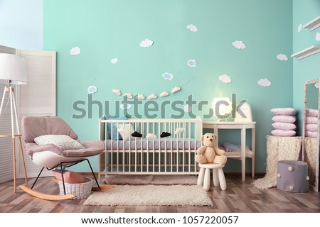 Modern baby room interior with crib and rocking chair