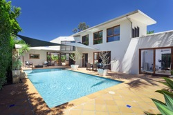Modern backyard with swimming pool in new white house