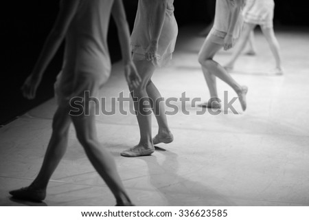Modern ballet dance performance, low section of dancers on stage