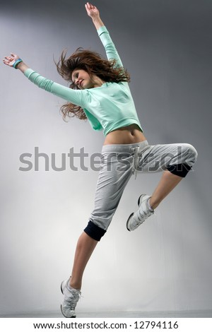 http://image.shutterstock.com/display_pic_with_logo/95919/95919,1211216303,3/stock-photo-modern-ballet-dancer-dancing-on-the-grey-studio-background-12794116.jpg