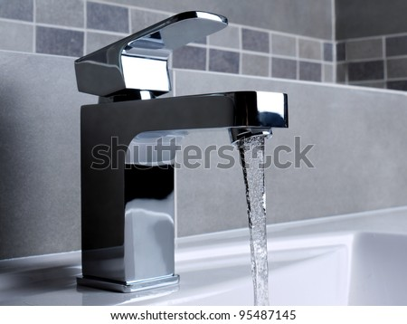 Modern Bathroom Faucets on Modern Bathroom Chrome Faucet With Running Water Stock Photo 95487145