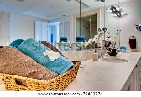 Modern bathroom decorated, focus on towels.