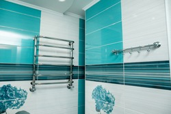 Modern bathroom design in blue. Bathroom interior. No brandnames or copyright objects.