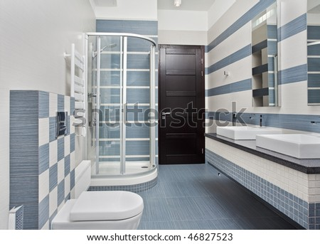 Modern bathroom in blue and gray tones with shower cubicle on wide angle view