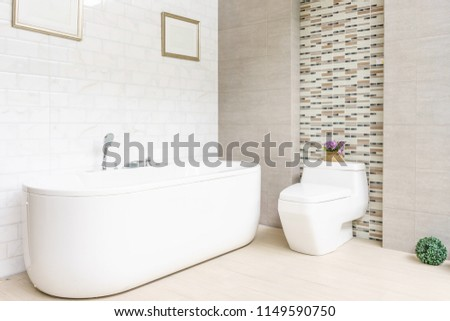 Modern bathroom interior with minimalistic shower and lighting, white toilet, sink and bathtub #1149590750