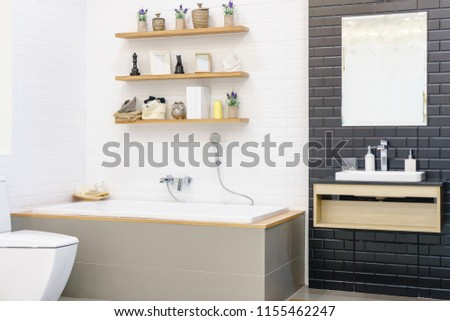 Modern bathroom interior with minimalistic shower and lighting, white toilet, sink and bathtub #1155462247