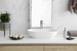 Modern bathroom interior with stylish mirror and vessel sink