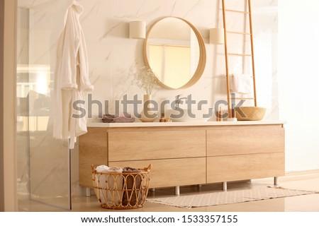 Modern bathroom interior with stylish mirror and vessel sink Photo stock ©