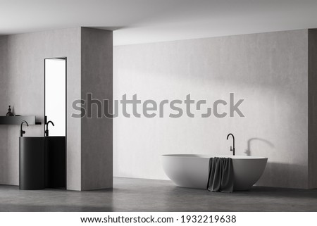 Modern bathroom interior with white bathtub and marble sink with rectangle vertical mirror, in eco minimalist style with concrete floor and walls. No people. 3D Rendering
