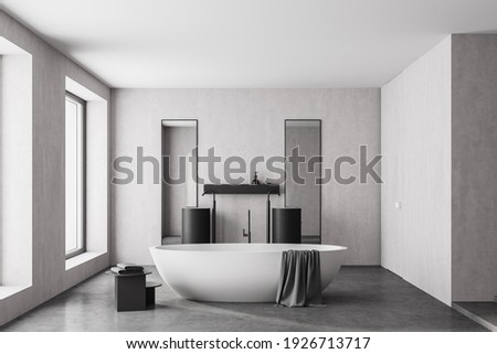 Modern bathroom interior with white bathtub and two marble sinks with rectangle vertical mirrors, in eco minimalist style with concrete floor and walls. Panoramic window. No people. 3D Rendering