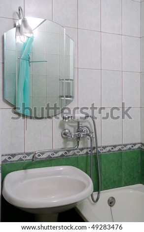 Modern bathroom of green colour