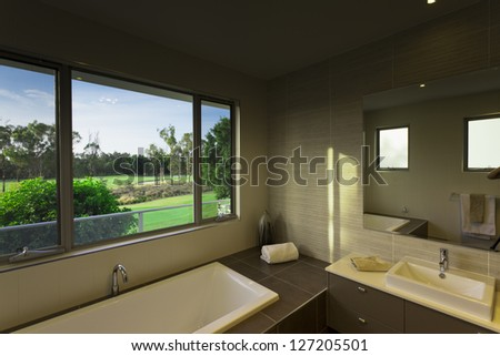 Modern bathroom over looking a golf course