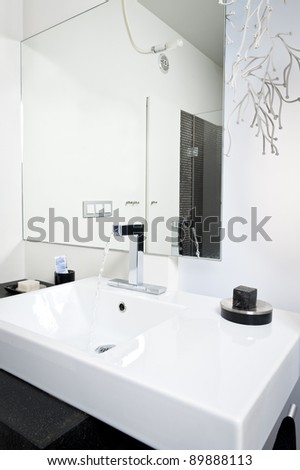 Modern bathroom white sink with flowing water