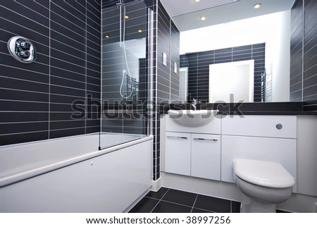 modern bathroom with black tiled walls