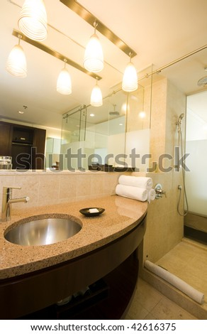modern bathroom with frosted glass room divider in luxury hotel port of spain trinidad and tobago