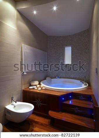 modern bathroom with large  bathtub with wood floor