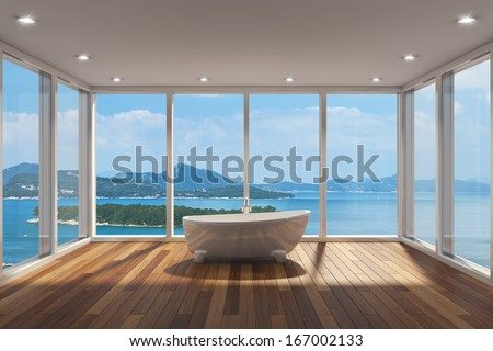 Modern bathroom with large bay window and view of sea