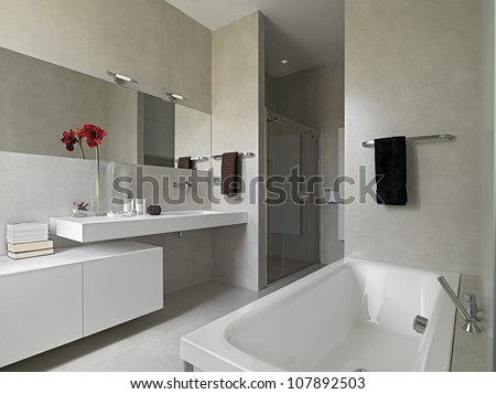 Modern bathroom with masonry shower cubicle and bathtub