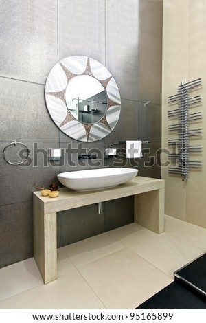 Modern Bathroom With Sparkling Tiles And Oval Mirror Stock Photo ...