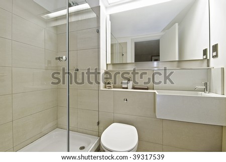 modern bathroom with stone tiles and shower corner
