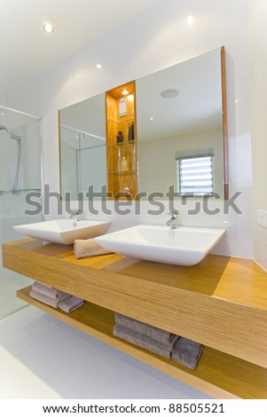 Modern Bathroom with Twin Sinks and Mirrors