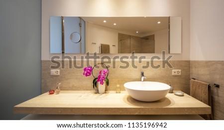 Modern bathroom with wood and marble finishes, elegant bathroom. Nobody inside