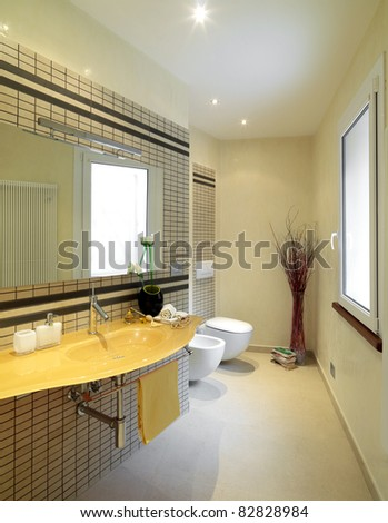 modern bathroom with yellow glass washbasin