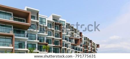 Modern beautiful luxury hotel resort building and blue sky in Pattaya city, Thailand - Panorama view