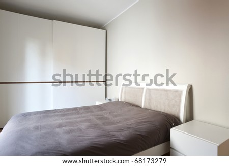modern bedroom, double bed and wardrobe #68173279