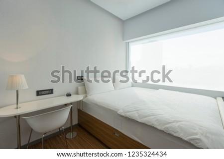Modern bedroom interior in the hotel. Interior of a hotel bedroom #1235324434