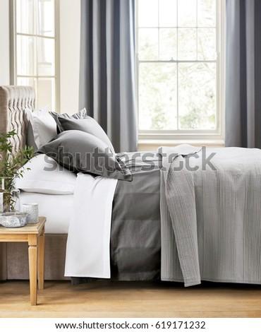Modern bedroom interior with double bed. Design bedroom interior in luxury apartment #619171232