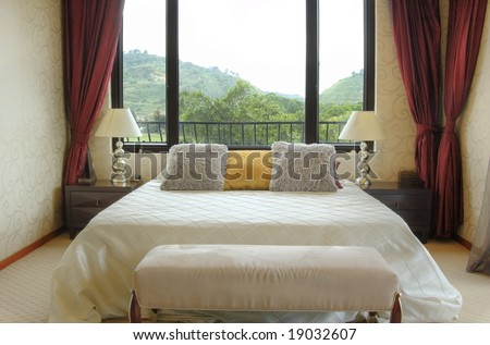 Modern bedroom with big window.