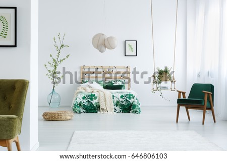 Modern bedroom with double bed, carpet, lamp, armchair and swing