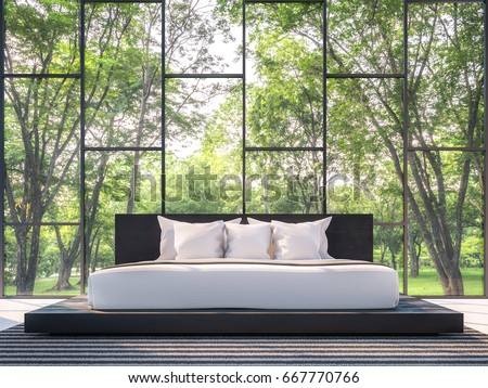 Modern bedroom with garden view 3d rendering Image.There are large window overlooking the surrounding garden and nature