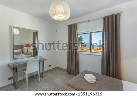 Modern bedroom with modern decor and furnishings. #1551196316