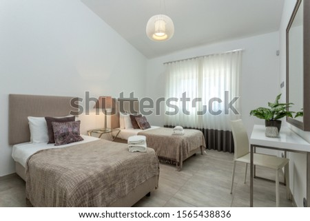 Modern bedroom with modern decor and furnishings. #1565438836