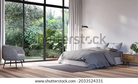 Modern bedroom with tropical style garden view 3d render,The Rooms have wooden floors ,decorate with gray fabric bed,There are large sliding doors, Overlooks wooden terrace and green garden.