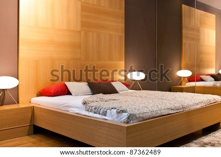 Modern bedroom with wooden wall - stock photo