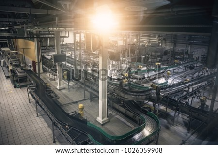 Modern beer factory, brewery concept. Steel empty conveyor and pipes for beer production. Industrial background, toned