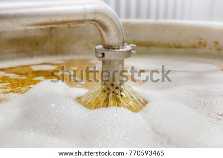 Modern beer plant brewery , with brewing kettles, vessels, tubs and pipes made of stainless steel, in a beer plant in Quito Stock photo ©