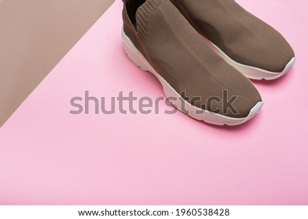 modern beige sneakers with white soles on multicolour background  Photo stock ©