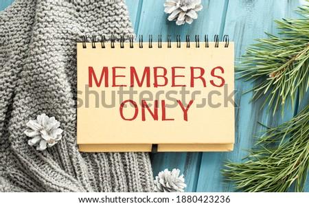 Modern beige Welcome members only zute doormat with key Stock photo ©