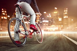 Modern bicycle in front of a nightly skyline