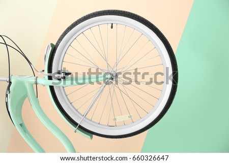 Modern bicycle on color background, closeup #660326647