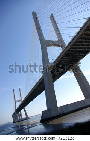 Modern big concrete bridge over Tagus River in Lisbon, Portugal.