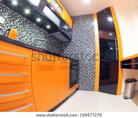 Modern Black And Orange Kitchen Stock Photo 168477278