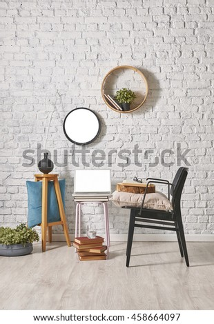 modern black chair and brick wall decor with round frame
